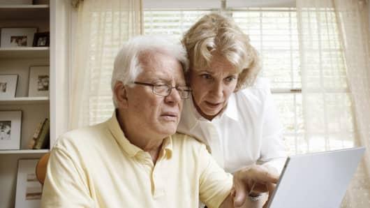 Senior retired couple with laptop
